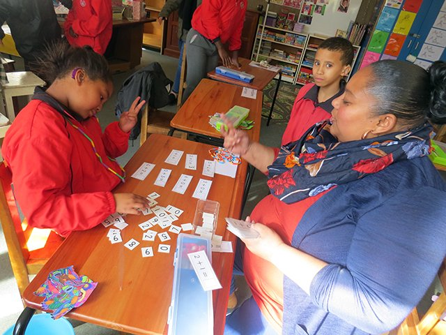 2 young coloured children learning maths